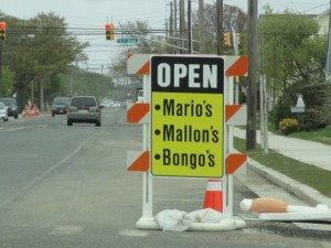 Signs let motorists know about businesses that remain open during a road construction project on Bay Avenue in Ocean City, NJ.