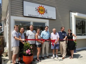 R.J. Idell, Jill Noon, Bob Idell, Sharon Idell, Councilman Mike DeVlieger, landlord Marvin Goldstein, Mayor Jay Gillian and Ocean City Regional Chamber of Commerce Executive Director Michele Gillian mark the opening of Sunrise Cafe.
