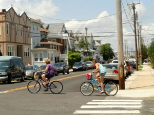 Bicyclists enter the intersection at 11th Street and Wesley Avenue on Aug. 11, 2014.   Credit: Tim Zatzariny Jr.