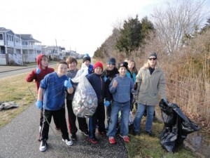 A group including (not in order) Aodhan Daly and his mom, Mary Daly (right), Bridget Dougherty, Sierra Ortiz, Brett Oves, Zachary and Sean Mazzitelli, Ricky Urban, Race Meyers and Justin Bush clean near the Howard S. Stainton Wildlife Refuge in Ocean City, NJ, during the annual Martin Luther King Day of Service in 2015.