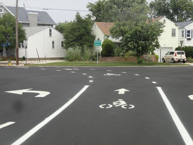 The repaved intersection of Inlet Road and West Atlantic Avenue includes new bicycle lanes.