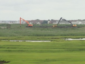Crews are working to make space at a disposal site for dredged material near Roosevelt Boulevard in Ocean City.