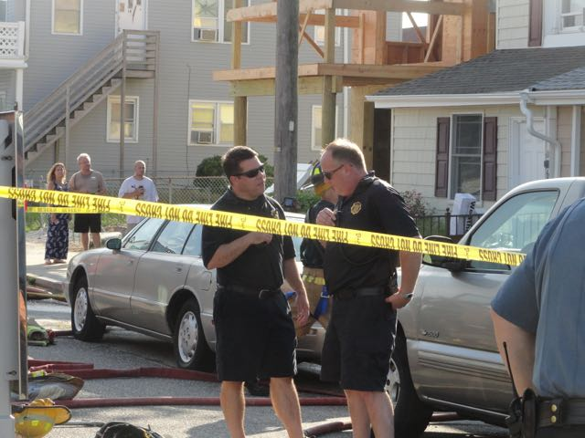 Deputy Fire Chief Jim Smith (left) talks with Fire Chief Chris Breunig at the scene.