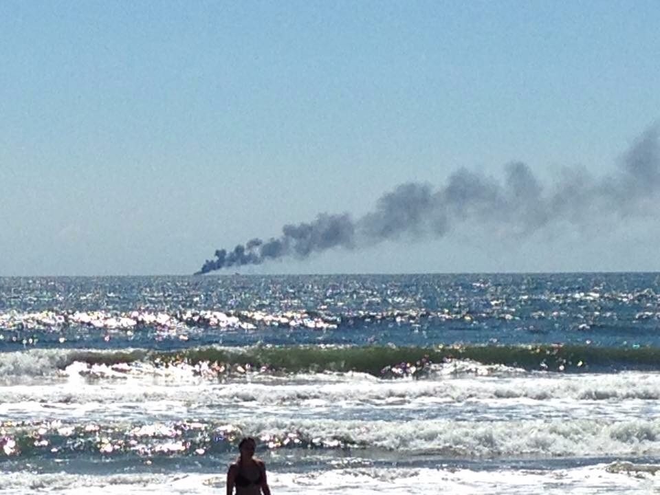 Coast guard rescues 2 after boat burns and sinks off ocean for Ocean city nj surf fishing report