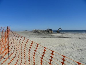 Machinery shapes the dune line, which currently ends where the southernmost house in Ocean City sits. The dune line will extend another couple hundred feet.
