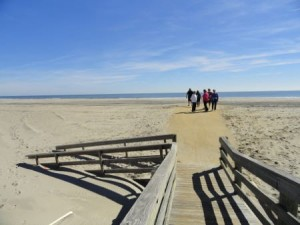 A new configuration of the boardwalk entrance to 58th Street Beach puts beach visitors at the back edge of a new dune line.