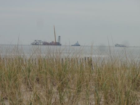 The dredge Illinois sits offshore at the north end of Ocean City on Monday afternoon (Nov. 2) and will begin to pump 700,000 cubic yards of new sand to help rebuild eroded beaches.