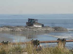 Bulldozers begin to shape the new beach at North Street in Ocean City on Tuesday morning.