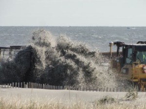 Slurry flies from a pipeline and onto the beach at St. Charles Place on Tuesday, Nov. 24.