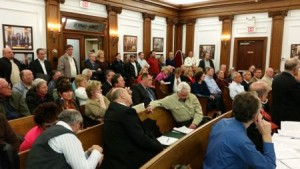 A crowd filled Council Chambers at City Hall on Jan. 13 for a Planning Board hearing on a proposed development adjacent to the Flanders Hotel.