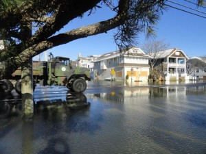 One of the city's military surplus vehicles capable of driving through flood waters drives past the flooded intersection of 11th Street and Bay Avenue on Sunday morning.