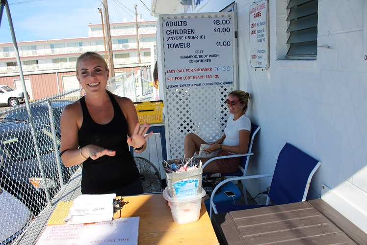 Bath House cashier Courtney Smith (foreground) and bath house attendant Maddie Barbieri at the 13th St. Bath House.