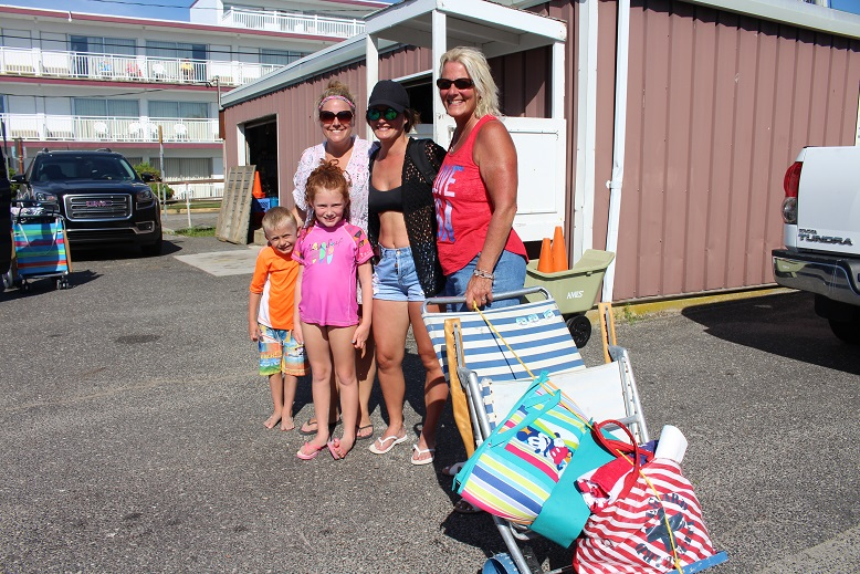 "Diane Christy (at right) has been ""day tripping"" to Ocean City every Wednesday in the summer for 24 years. With her at the Bath House parking lot were (from Left) Luke Wright, Michelle Wright, Mikayla Wright and Gina Christy."