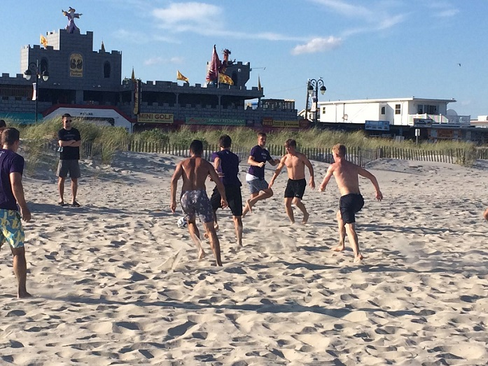 Northwestern's men's soccer team scrimmaging on the OC beach during their recent camp here.
