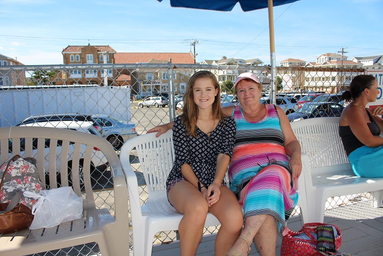 Susan Blevins and granddaughter Sedona, who took a bus to Ocean City from Lancaster, Pa., relax after showering.