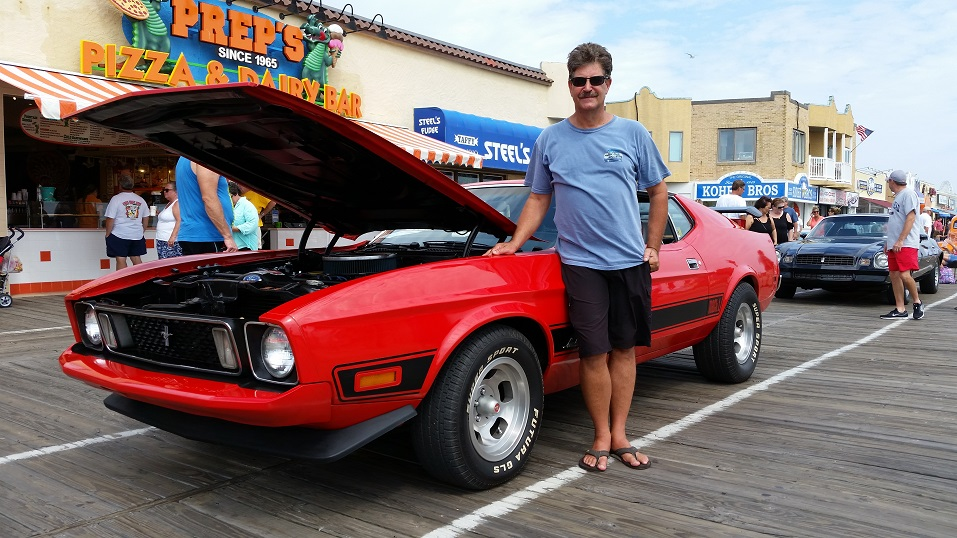 Ron Melvin, of Hilltown, Pa., shows off his 1973 Ford Mustang Mach 1 that took him two years to fully restore.