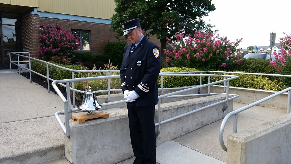 Fire Capt. Gary Green solemnly tapped a silver bell during an old firefighting tradition that honored the 9/11 victims.