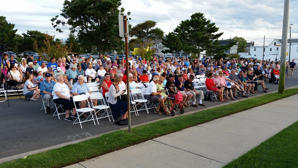 Hundreds of people watched the ceremony from a closed-off portion of Asbury Avenue in front of the fire headquarters.
