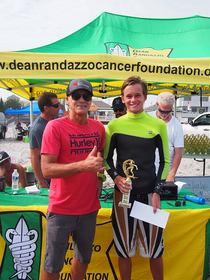Evan Couval, 14, of Brigantine receives his first-place trophy for the boys division at the 16th annual Surf for a Cause in Margate.