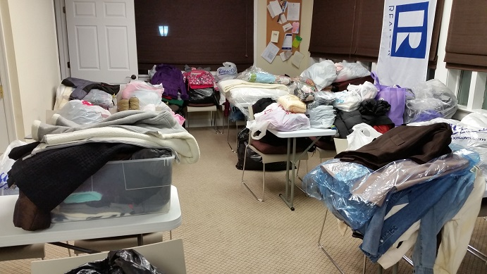 Virtually an entire room at the Board of Realtors office on 22nd Street is stocked with donated clothes and bedding.