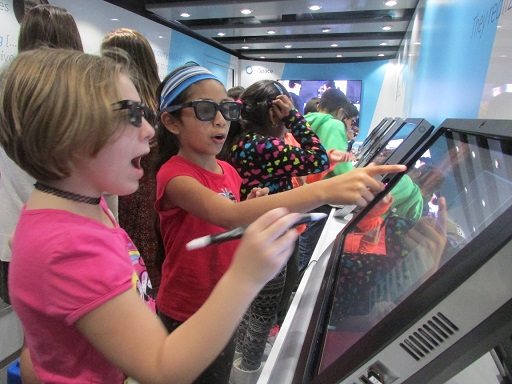 Second- and third-graders from Ocean City Primary School, including Caylee Borman and Suzy Bautista-Rodriguez, partnered-up and wore special glasses in order to interact with the zSpace bus.