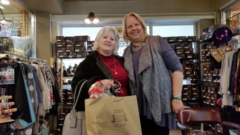 Customer Agnes Jonczak, of Bensalem, Pa., joins Voudouri at the shops. She bought some gifts for herself and her family.