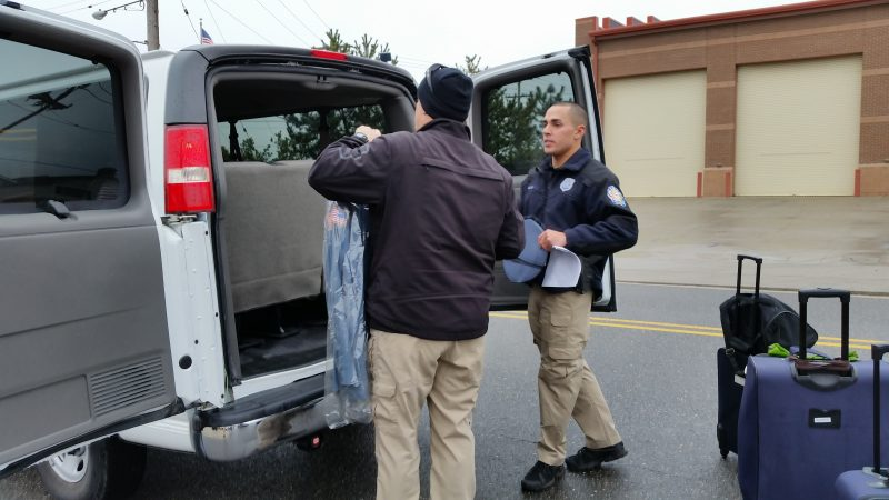 Officers packed their uniforms and other gear into a van for the trip to Washington.