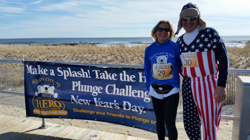 Denise and Jim Berghaier, who have a summer home in Ocean City, pose in front of a Boardwalk banner promoting the HERO Campaign plunge. Jim wore a colorful costume for his first ever plunge.