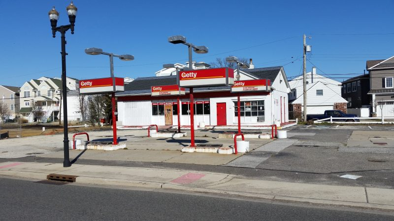 Plans call for demolishing the old Getty gas station and transforming the site into a park after the city buys it.