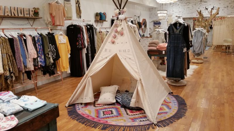 A tepee that serves as a children's play area is one of the decorative centerpieces of the shop.