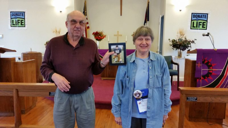 Tom and Vivian Gano display a photo of their late son, Curtis, who was an organ donor.