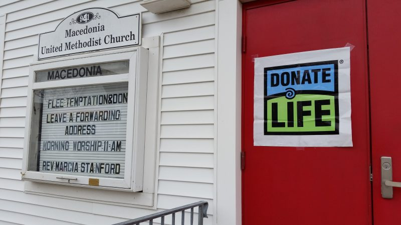 A sign on the door of the Macedonia United Methodist Church urges people to become organ donors.
