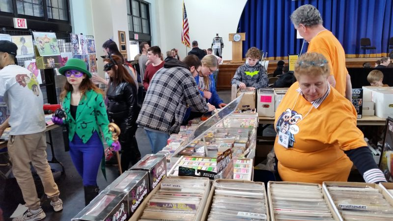 Crowds browsed through memorabilia sold by vendors on the Music Pier floor.