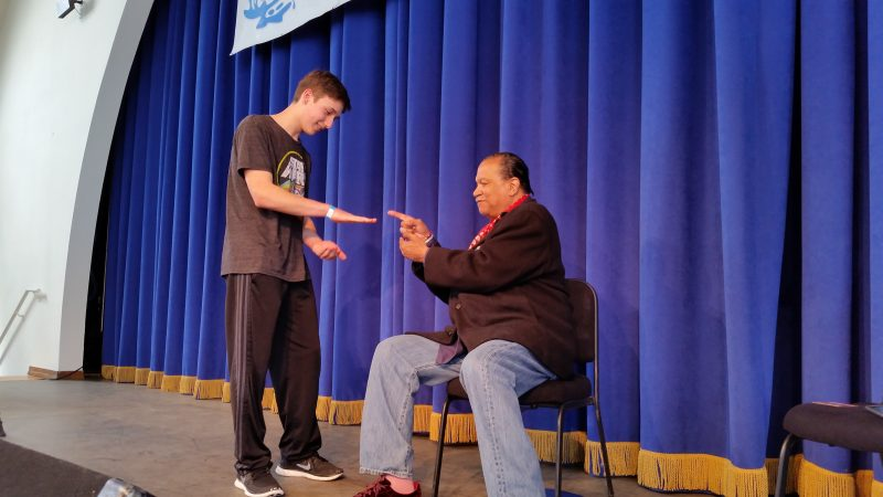Kai Tripician joined Billy Dee Williams on stage for a game of rock-paper-scissors in a pretend bet for control of the Millennium Falcon spaceship.