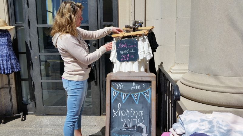 Shopper Julie Agnew checks out some discounted clothing at the Island Gypsy boutique on Asbury Avenue.