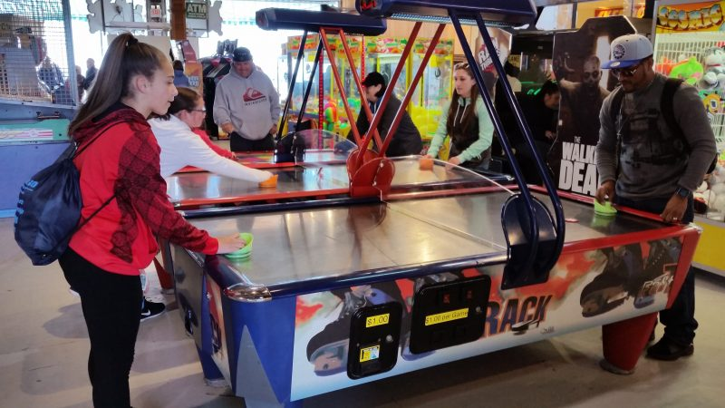 Air hockey is one of the old-style games in Playland's arcade.